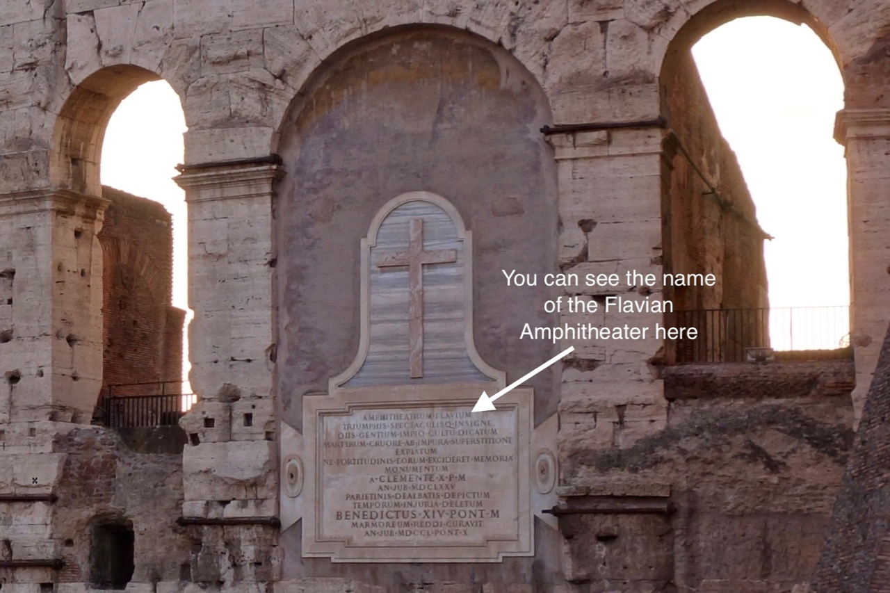 a sign on the colosseum wall naming the