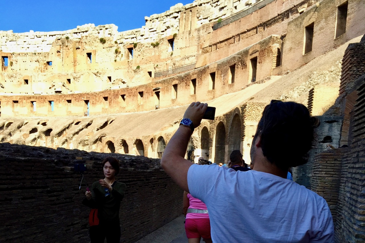 using selfie sticks inside the colosseum