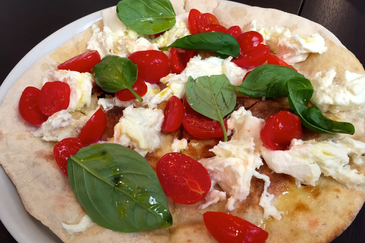 focaccia with buffalo mozzarella, plum tomatoes and basil at pizzeria emma
