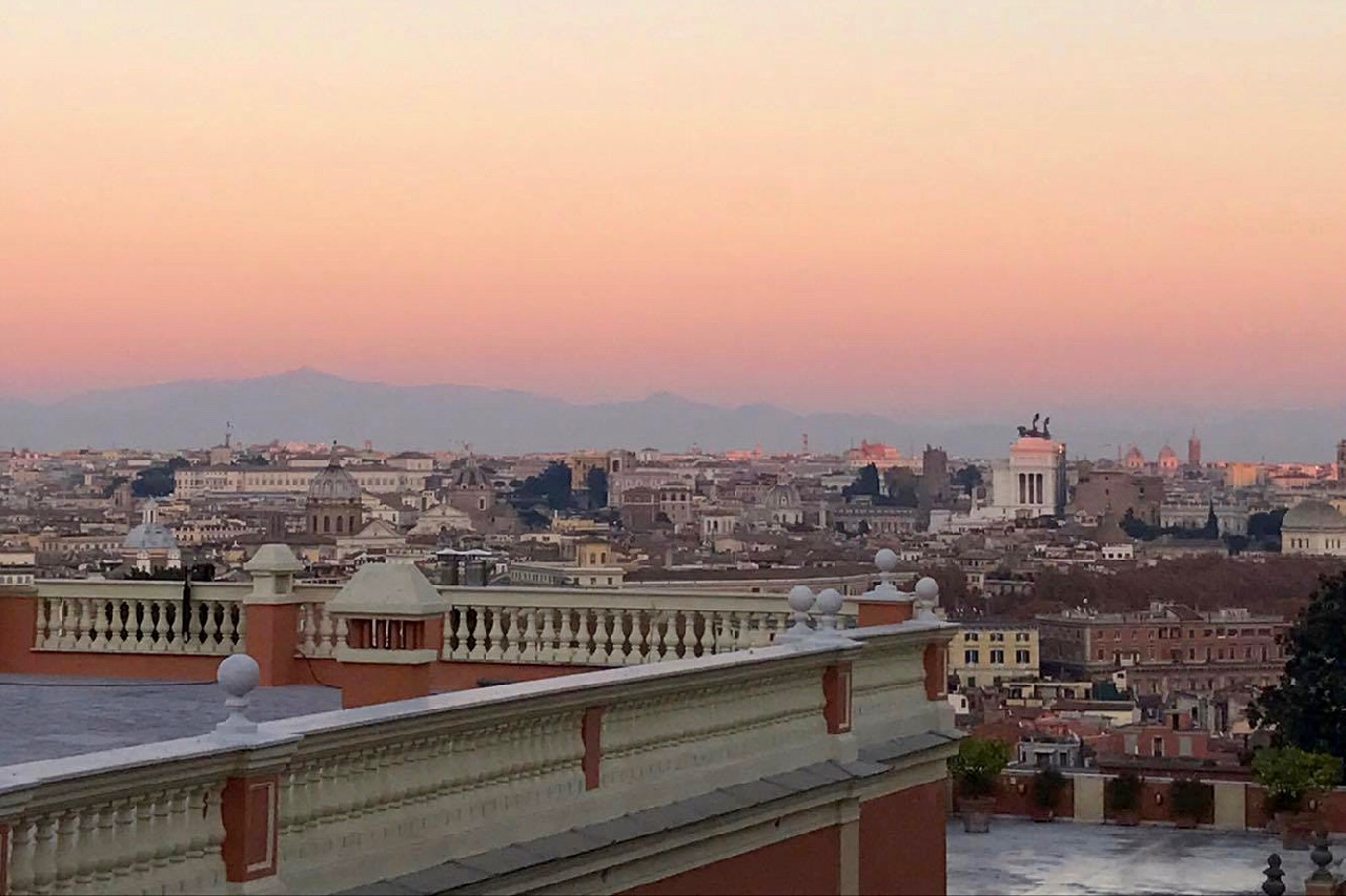 pink sunset from gianicolo hill in rome
