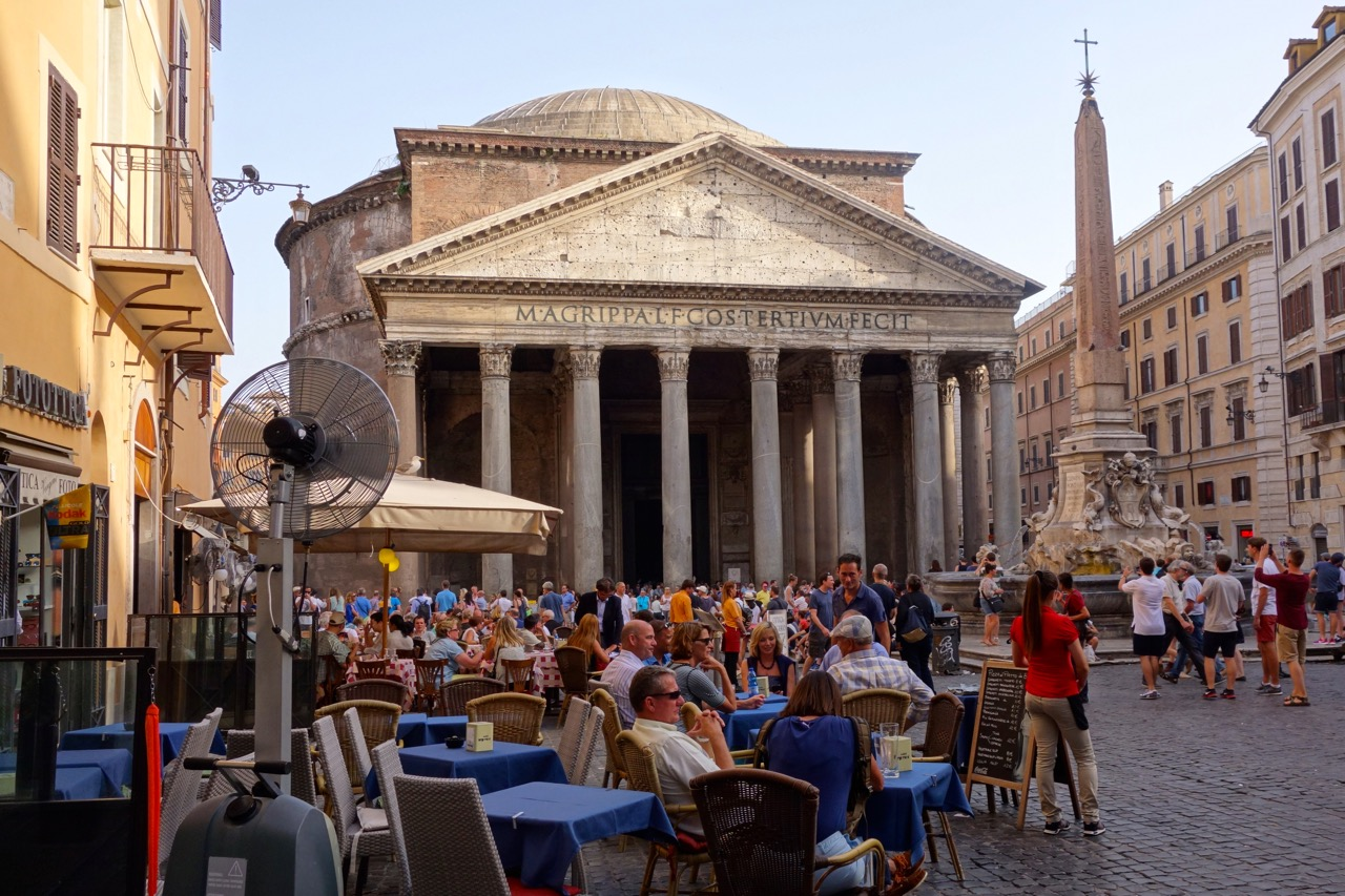 people sitting on the piazza Rotunda in front of the Rome pantheon