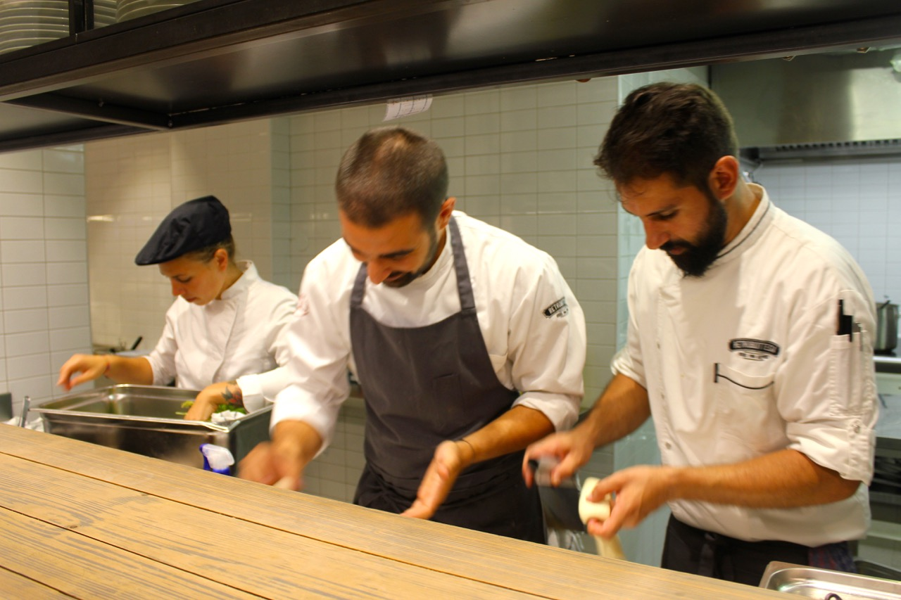 chefs in open kitchen at retrobottega