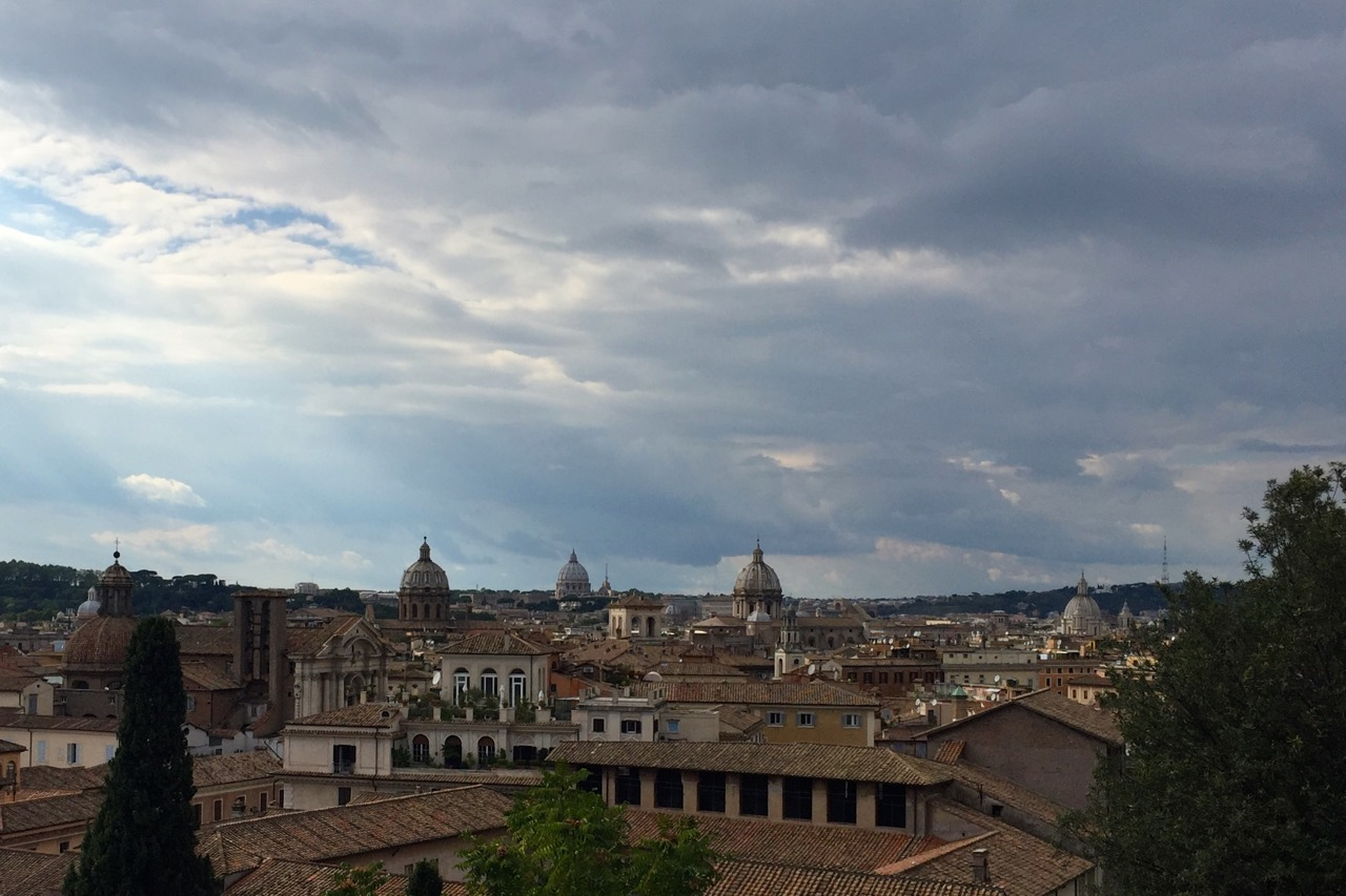 cloudy skies and rome rooftops from capitoline museums roof
