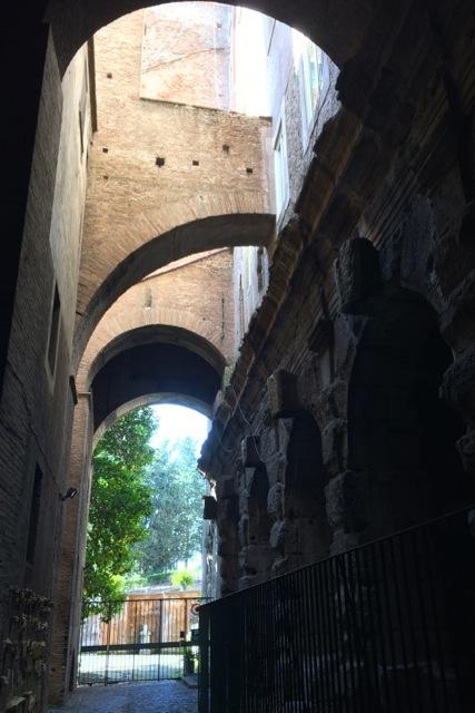 travertine roman ruins under the bell tower at santi giovanni e paolo