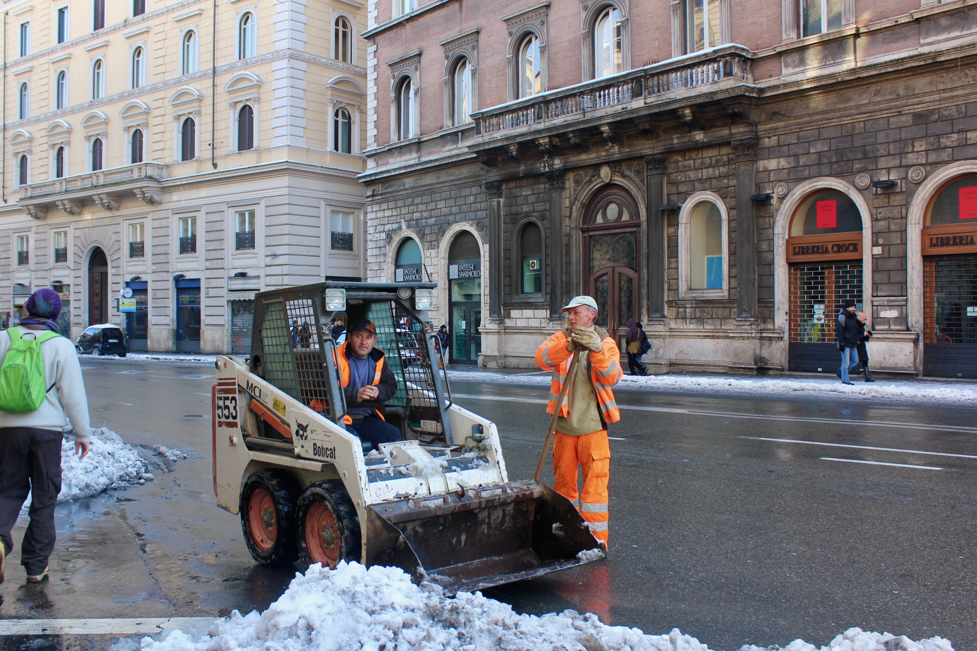 removing snow from Rome street