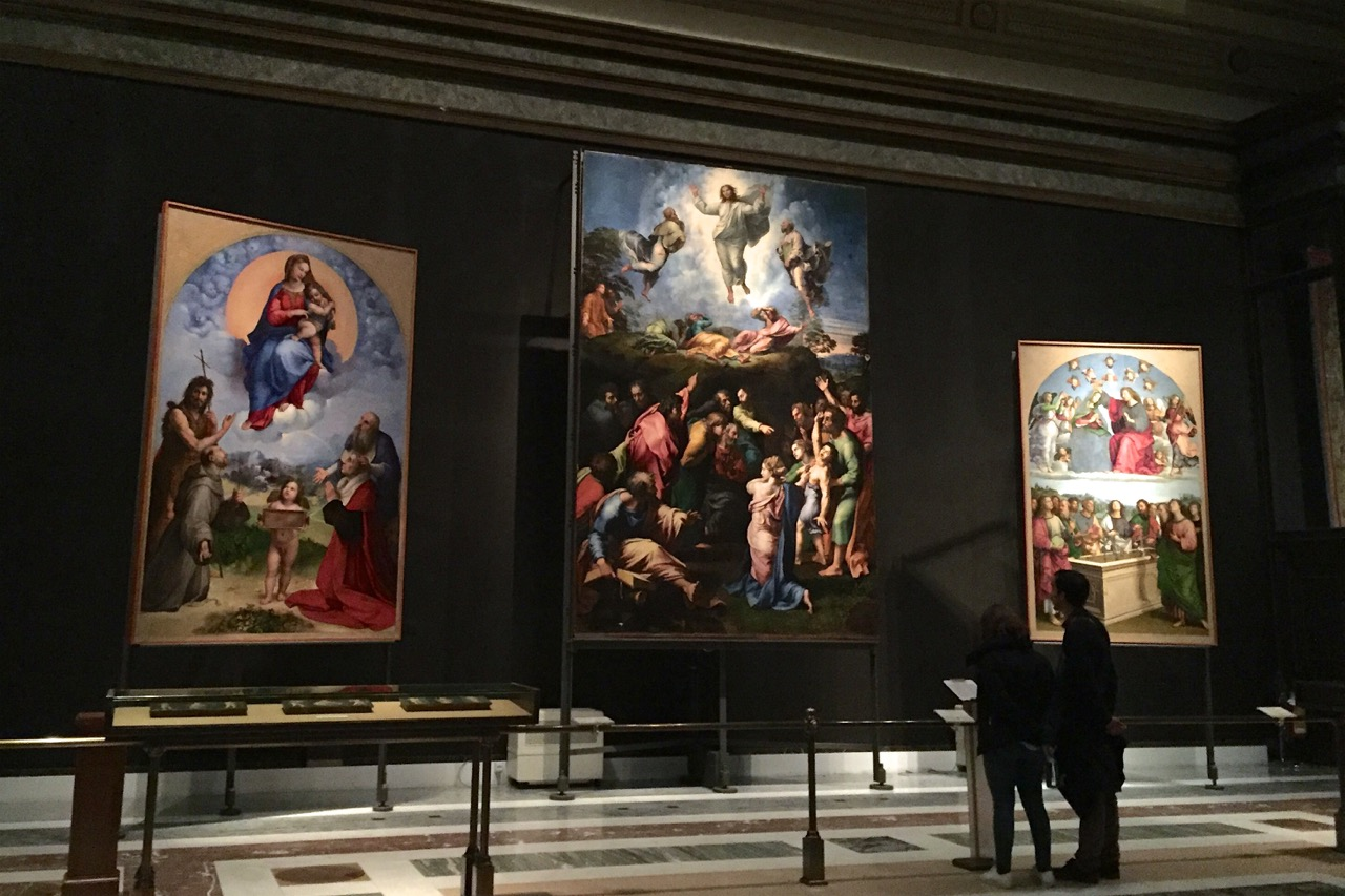 Raphael's Transfiguration flanked by two other of his paintings