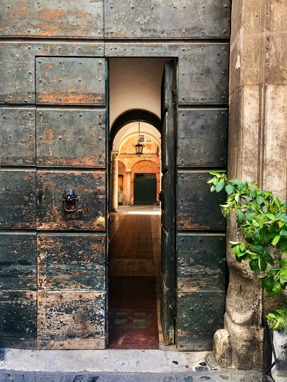 i love taking photos of doorways in rome, especially when they are open!