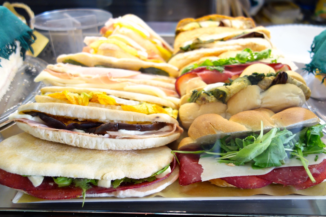 sandwiches on display at a bar in Rome