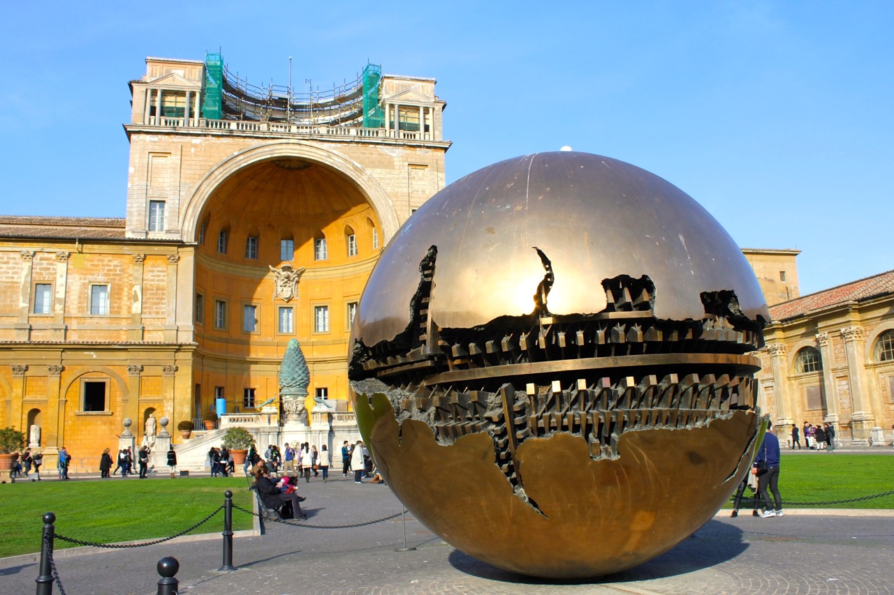 pinecone courtyard and sphere by Arnaldo Pomodoro
