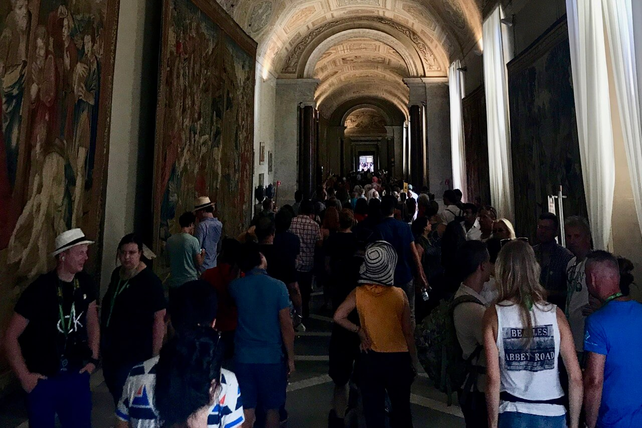 vatican museums tapestries room with crowds